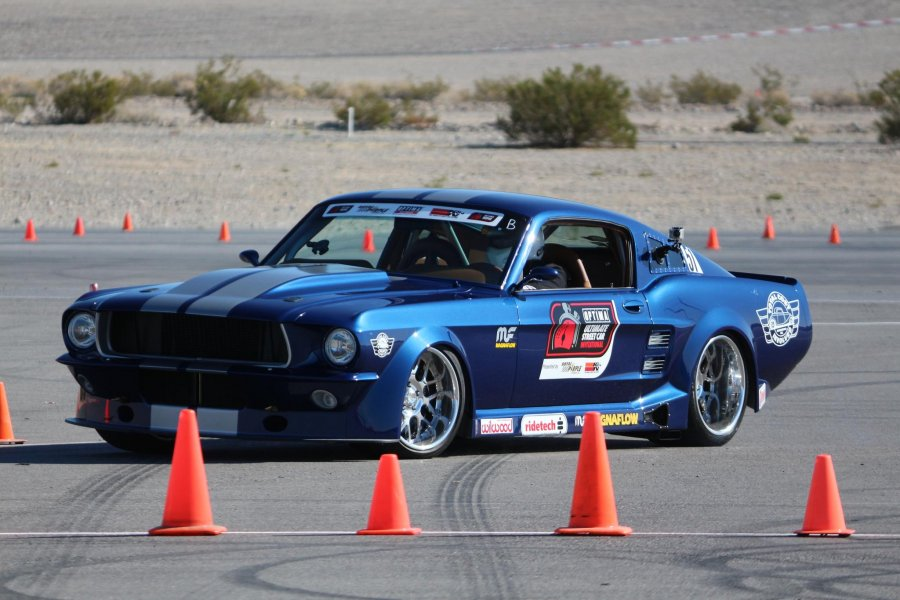 Ed Moss (owner of TCI Engineering) driving his 67 Mustang equipped with RideTech TQ CoilOvers